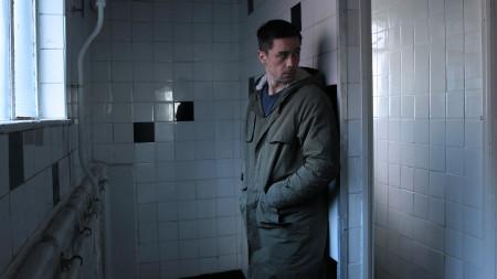 Killian Scott waits in toilet